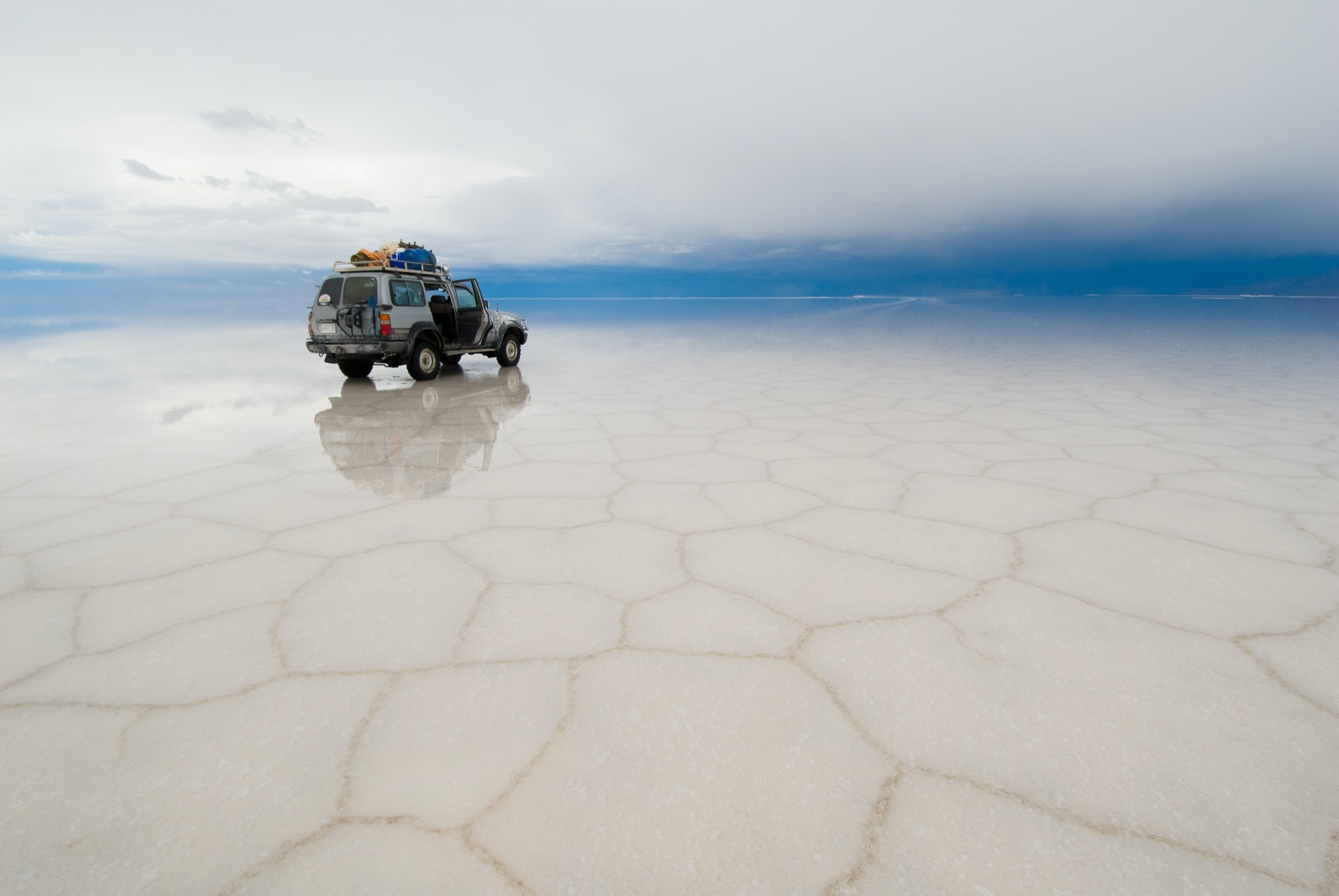 Jeep in the salt lake of Salar de Uyuni, Bolivia
